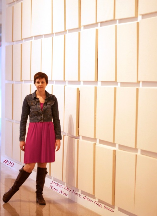 Girl standing in front of art